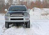 Snowy winter road ahead an unrecognizable car