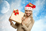 smiling christmas girl with gift box