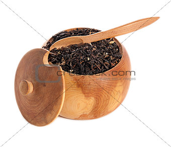 black tea leaves on wooden ware  isolated on white background