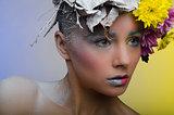 Woman in a wreath of flowers