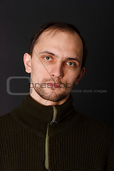 man in an old sweater