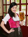 Beautiful woman drinking Oktoberfest beer