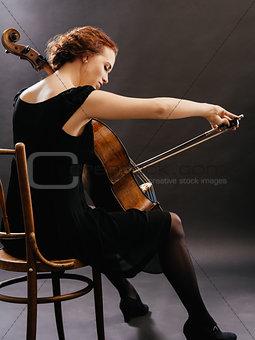 Cello player enjoying her music