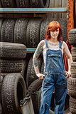 Sexy redhead mechanic with tattoos