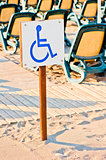 sign wheelchair set on the beach by the sea