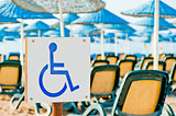 sign wheelchair close-up on the beach