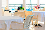 table covered with a white tablecloth and wicker chairs