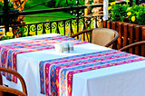 table covered with a tablecloth in a restaurant with Turkish ornament