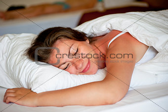 beautiful girl luxuriating in bed at dawn