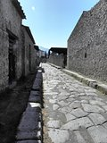 Preserved remains. Streets and colonnades of the ancient Roman city of Pompeii