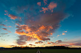 Beautiful sunset with meadow and dirt road