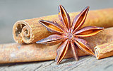 anise star and cinnamon sticks, on wooden table