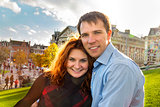 Outdoor happy couple in love posing in Museum Plein, autumn Amst