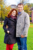 Outdoor happy couple in love posing against autumn Amsterdam bac