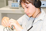 Portrait of a sweet young boy listening to music on headphones