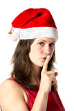 Santa woman with finger at mouth