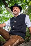 Sitting traditional Bavarian man