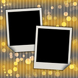 Two blank photo frames on festive bokeh background