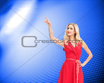 Composite image of smiling blonde pointing