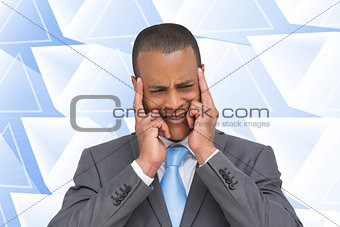 Composite image of stressed businessman putting his fingers on h