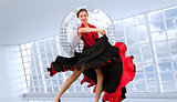 Composite image of dancing woman in a red and black dress