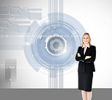 Composite image of a confident businesswoman with folded arms ag