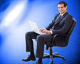 Composite image of young businessman sitting on an armchair work