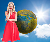 Composite image of thoughtful blonde wearing red dress