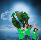 Composite image of enviromental activists jumping and smiling