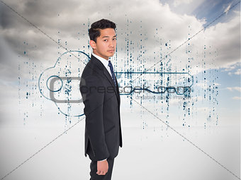 Composite image of serious businessman looking at camera