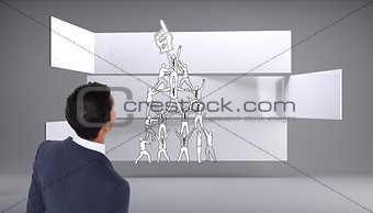 Composite image of casual businessman walking