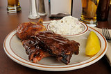 Barbecue chicken and ribs in a bar