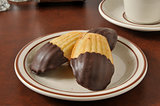 Madeleines dipped in chocolate