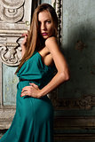 Sexy beautiful woman green gown in palace.