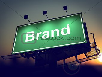 Brand on Green Billboard at Sunrise.