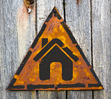 Home Icon on Rusty Warning Sign.
