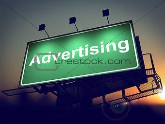 Advertising on Green Billboard at Sunrise.