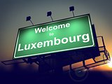 Billboard Welcome to Luxembourg at Sunrise.