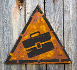 Briefcase Icon on Rusty Warning Sign.