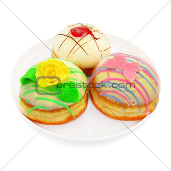 Three donuts with white chocolate