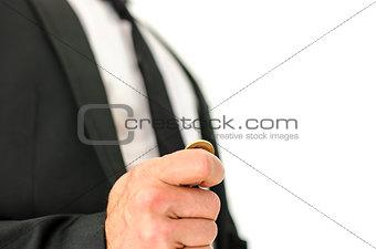 Business man flipping a coin