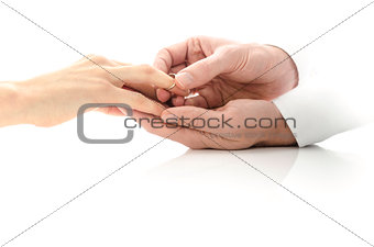 Close up of putting an engagement ring on the finger
