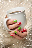 Woman with Red and Green Nail Polish Holding Cup of Coffee