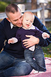 Infant Boy and Young Military Father Play in the Park