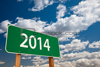 2014 Green Road Sign Over Clouds