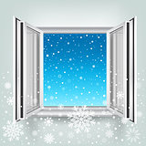 open window and falling snow