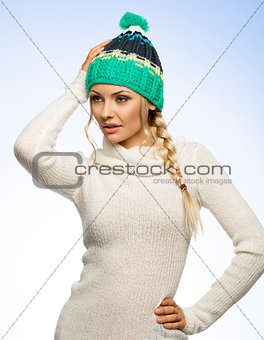 blond young woman in winter dress