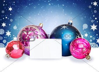 Christmas balls, snowflakes and white card