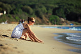 Beautiful young caucasian woman relaxing on the beach