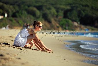 Beautiful young caucasian woman relaxing on the beach